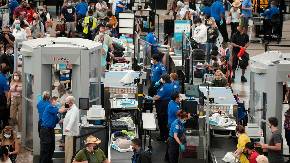Pandemic's Busiest Airport Travel Weekend Met With Chaos And 'Extremely High' Volume Amid Worker Shortages And Flight Cuts