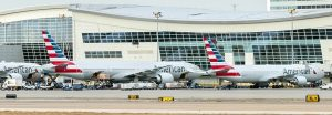 American invests in hubs, hires thousands as travel rebounds